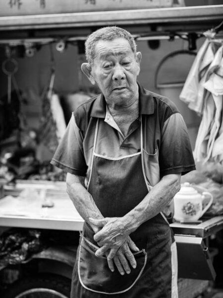 Portrait taken of a food stall operator in Chinatown - Kuala Lumpur