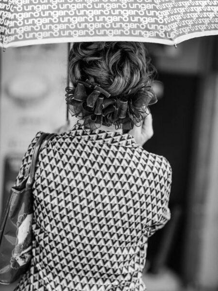 Woman holding umbrella with patterned blouse in Pasar Seni, Kuala Lumpur – Malaysia