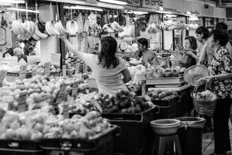 TTDI wet market fruit store shopper selecting a bunch of bananas - KL - Malaysia
